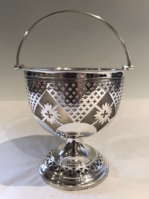 Antique silver plated dish attractively pierced throughout with beaded decorated swing handle and original frosted glass liner (c.1900)